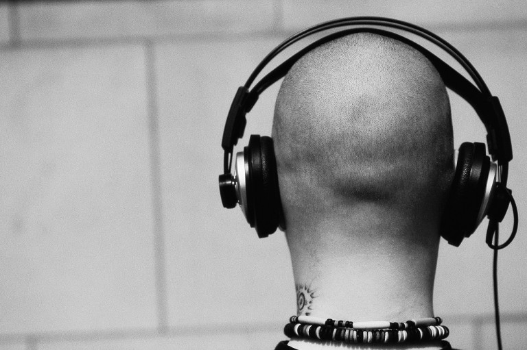 Bald Man Wearing Headphones